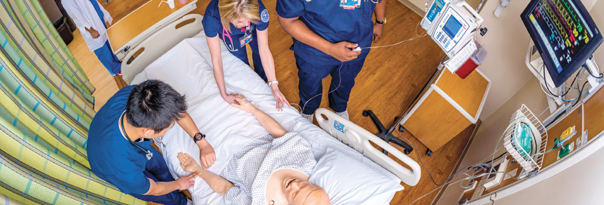 Nursing students with patient simulator