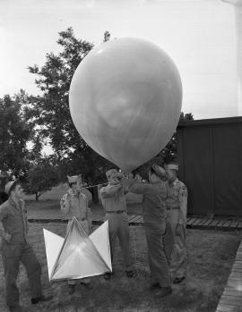 servicemen demonstrating weather balloon