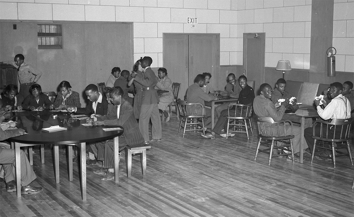 Soldiers and visitors playing bingo and card games