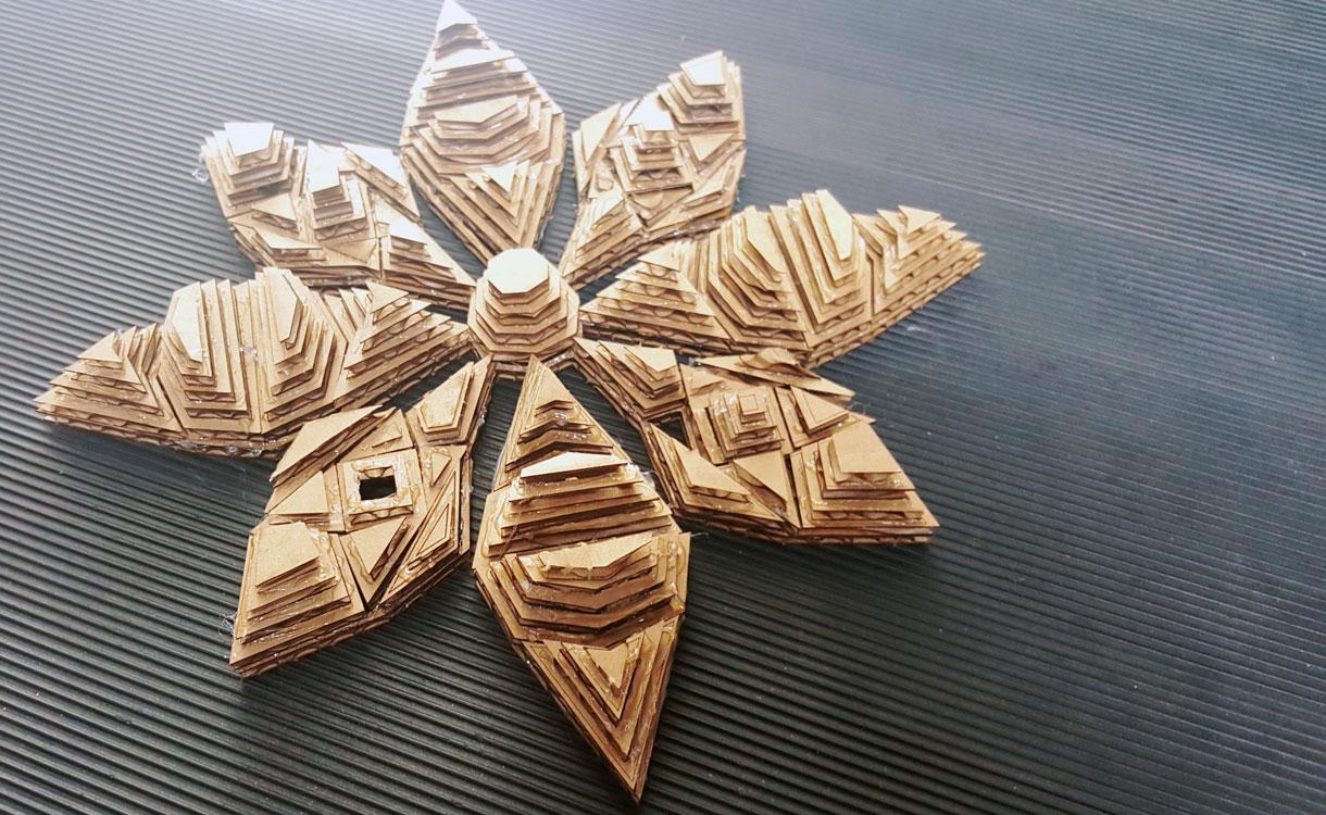 laser-cut cardboard poinsettia