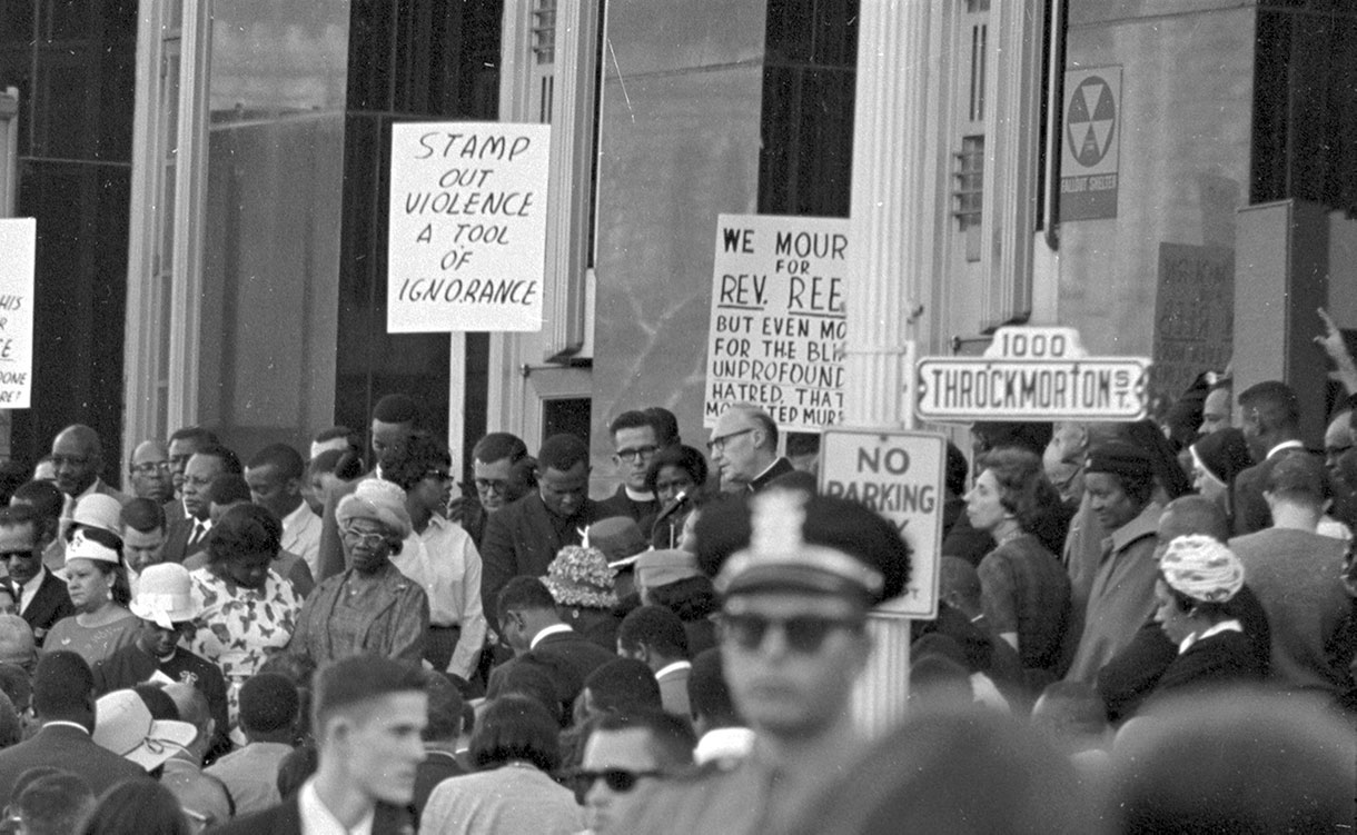 civil rights protesters carrying sign saying, Stamp Out Violence: A Tool of Ignorance