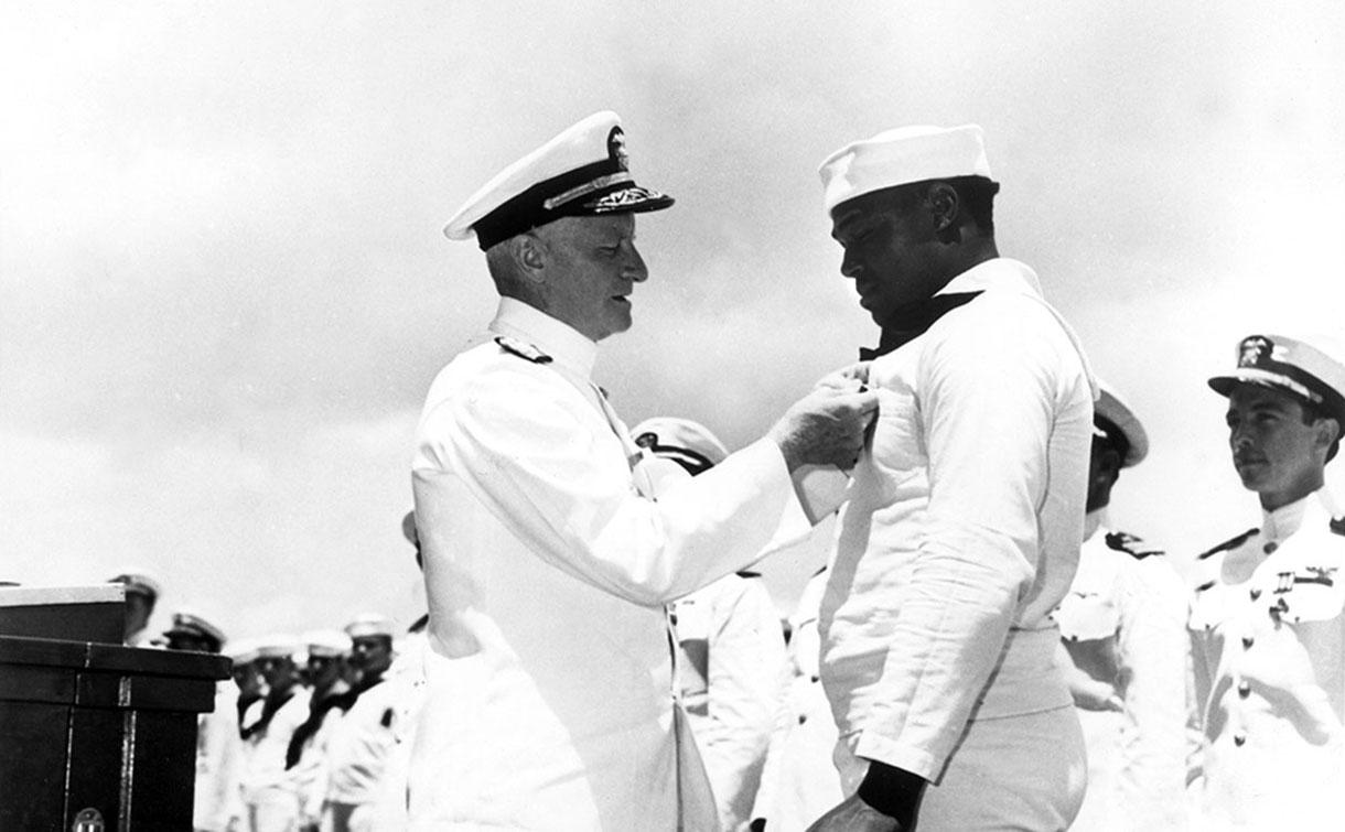Admiral Nimitz awards the Navy Cross to Dorie Miller