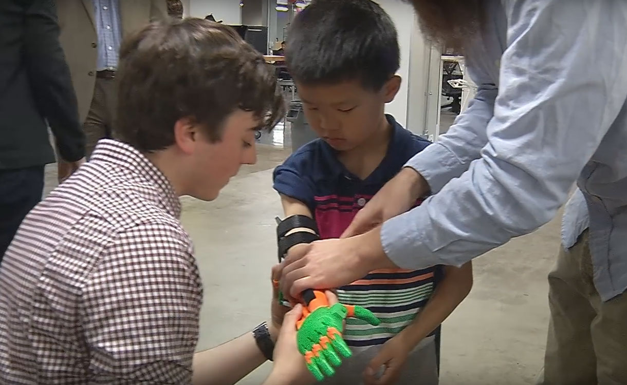 Boy being fitted with prosthetic in UTA FabLab