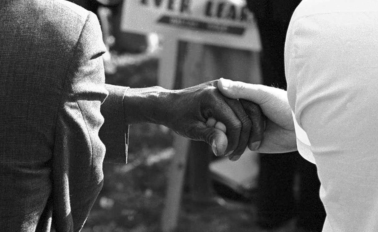 protesters holding hands at civil rights protest