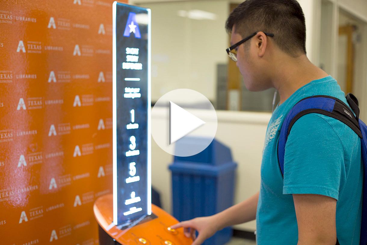 student standing in front of short story dispenser