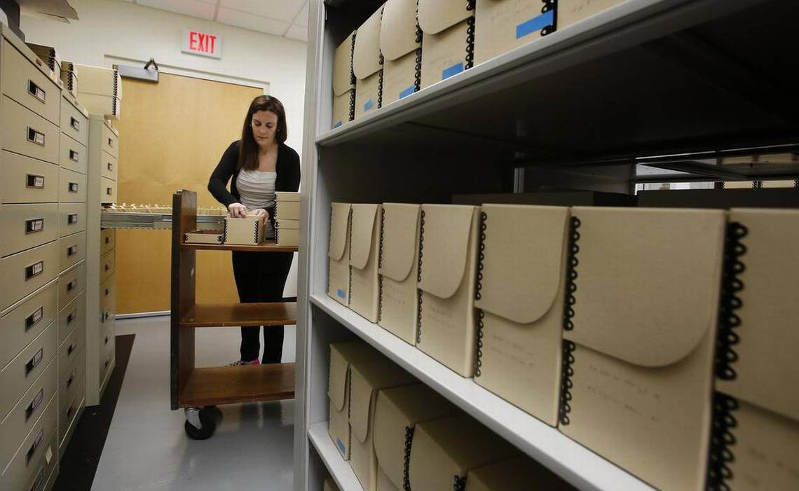 Special Collections archivist, Samantha Dodd, sorts and boxes old film negatives (photo: Brad Loper)