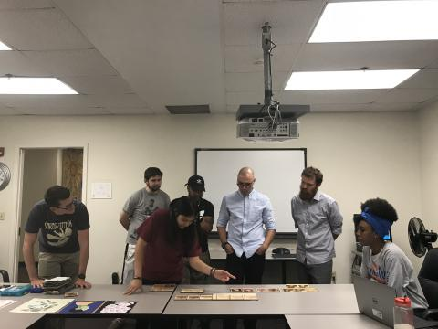 UTA FabLab student workers gather to critique each others' work as part of staff training.