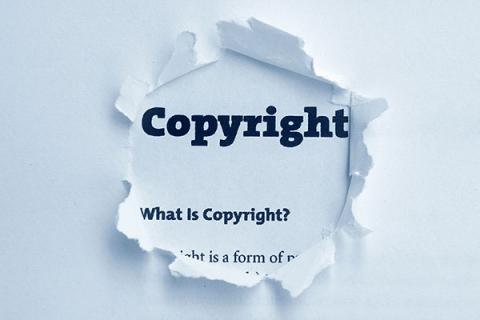 "Torn paper with the word ""Copyright"" printed on it"