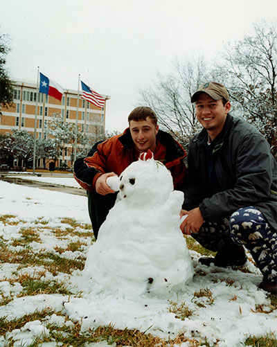 students in front of Central Library with snowman