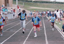 3 children racing on a track