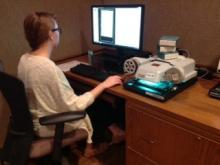 Student using digital microfilm reader