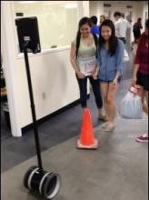 Students checking out a telepresence robot