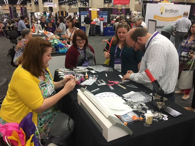 Katie Musick Peery and Andy Herzog helping conference goers bling their badges