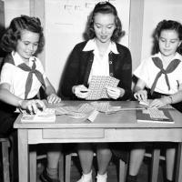 Camp Fire Girls prepare sheets of Christmas Seals