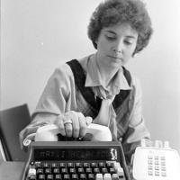 woman demostrating a TTY or a text telephone