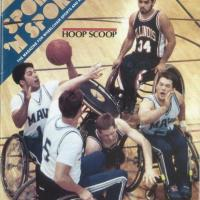 players clash in a wheelchair basketball game