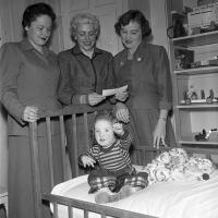 women present check and visit a child receiving treatment