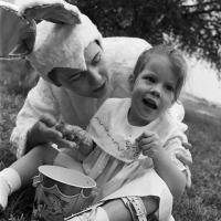 Child with cerebral palsy and an adult dressed in a bunny costume