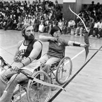 college students show athletic prowess with archery from their wheelchairs for high school students