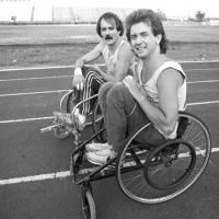 two men in wheelchairs on a racing track