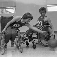 two boys play wheelchair basketball