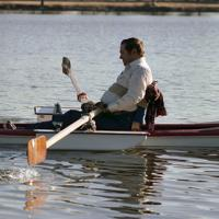 Rocky Giesecke of Hurst, a paraplegic, rows in a specially designed boat
